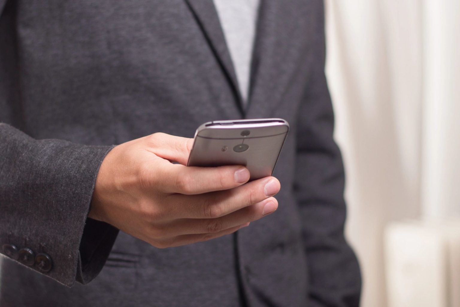 mobile phone in hand ebs functional consultant